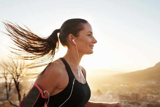 A woman jogging at sunrise