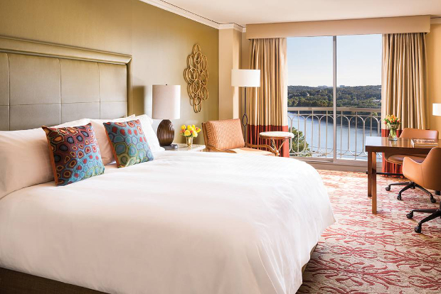 A view of the interior of one of the Four Seasons Austin's rooms looking out to Lady Bird Lake