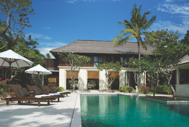 A view of the facade of one of the Four Seasons's villas and pool area