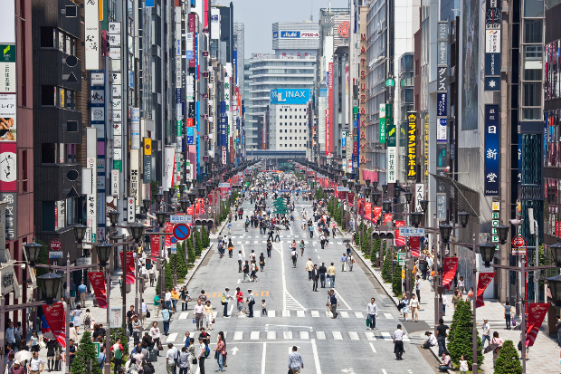One of the streets in Ginza with people shopping