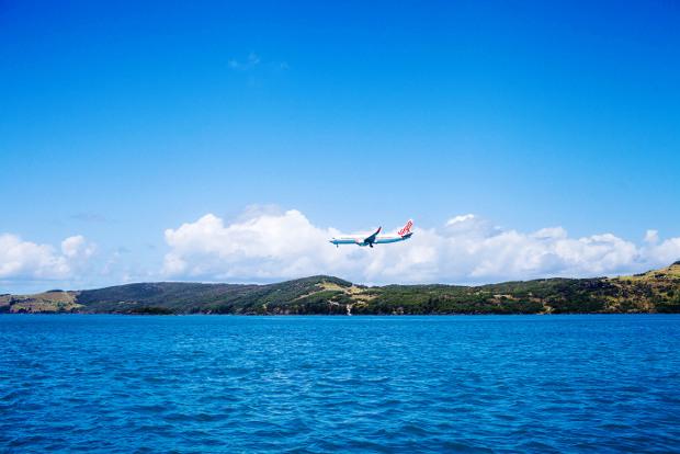 A plane arrives at Hamilton Island.