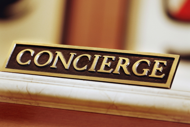 A concierge sign sitting on a desk