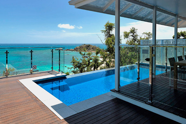 A view of the ocean over the pool of a room at Lizard Island Resort