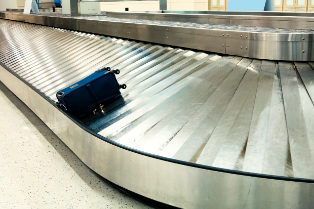 Baggage carousel with a single bag on it