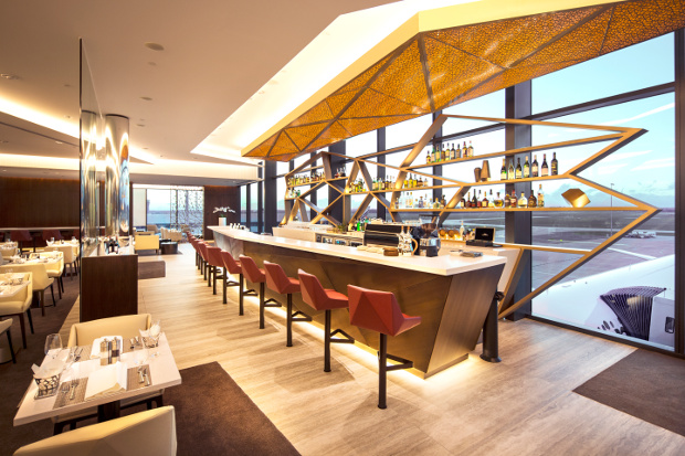 A closer view of the bar area with the runway views behind
