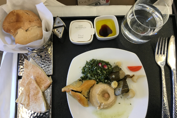 Looking at a mezze plate with various dips and breads