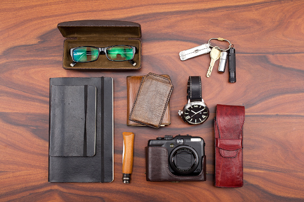Glasses, keys, watch, books and camera