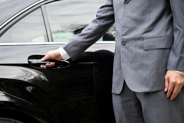 A driver opening a car door