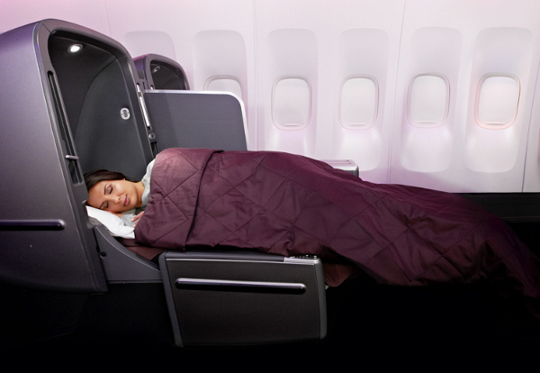 Woman sleeping in a business class seat