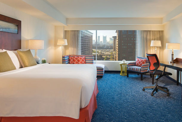 A view of one of the rooms looking out to the Boston city skyline at the Renaissance Boston Waterfront Hotel