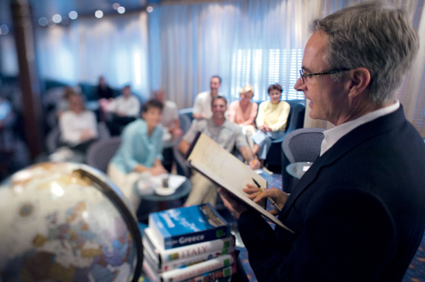 A man giving a lecture onboard