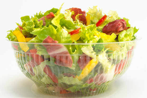 A salad in a plastic to-go bowl