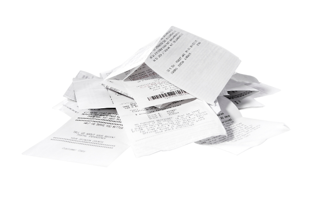A pile of paper receipts