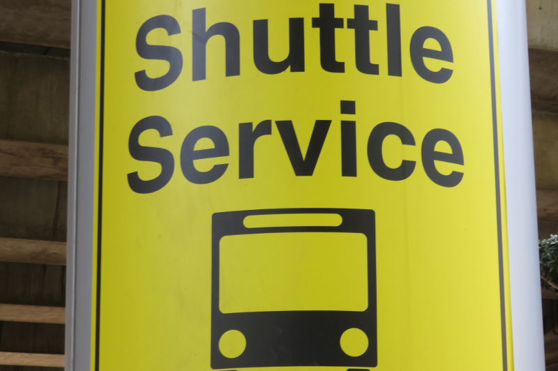 A shuttle service sign at the airport