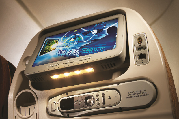 A seatback entertainment screen in economy class