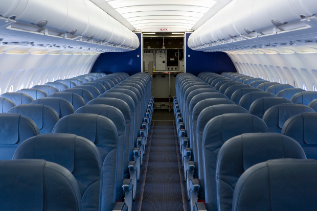 The interior of an aircraft economy cabin