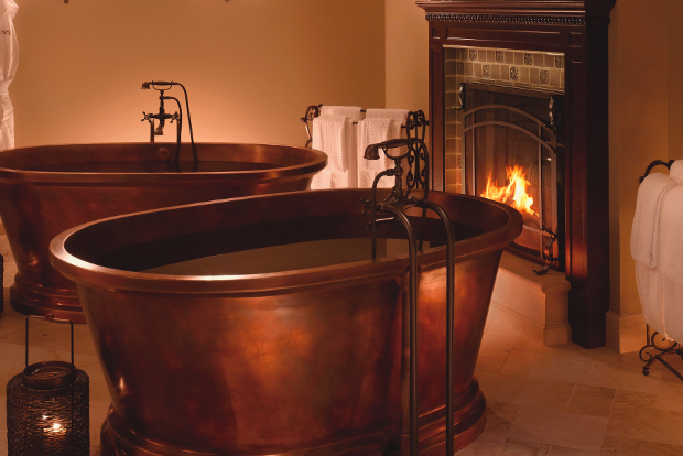 The Serenity Suite at Spa Montage Deer Valley features two copper bathtubs by a fireplace.