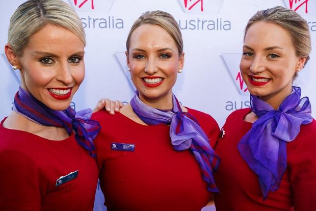 A close up of three flight attendants in Virgin Australia uniforms
