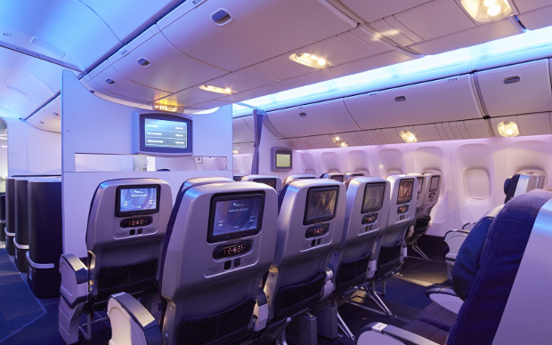 Rear view of the Premium Economy cabin showing the entertainment systems