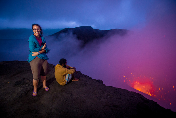 Tourists stand on the lip of Vanuatu's Mt Yasur volcano.