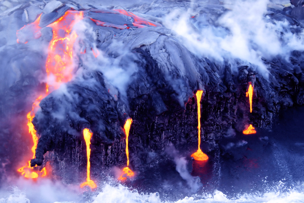 Hot magma flowing into the ocean creating steam