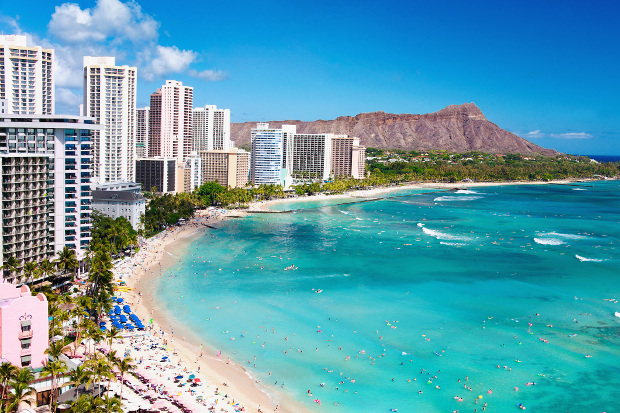 A view of the hotels fronting the blue ocean waters at Waikiki Beach