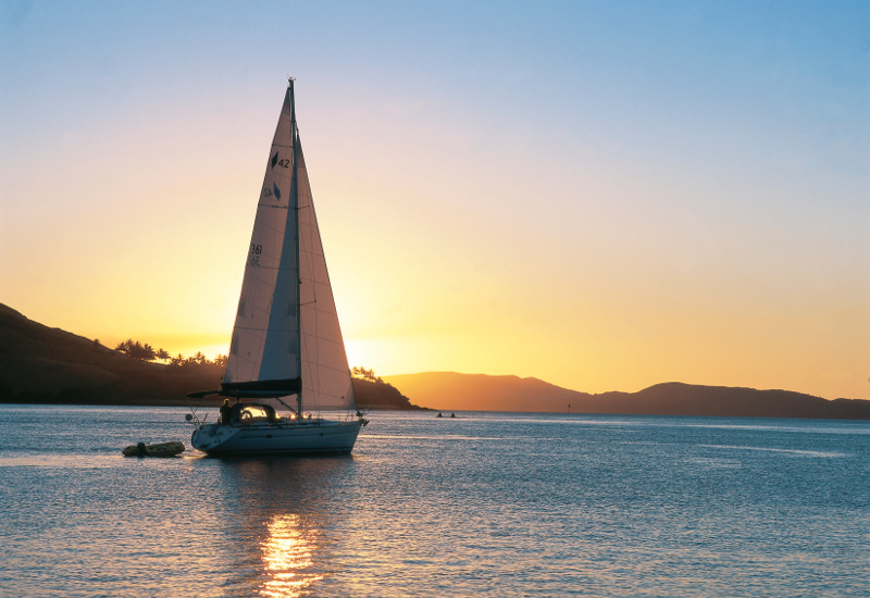 Yacht sails in Dent passage, just off Hamilton Island, Queensland, Australia