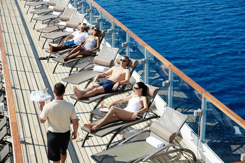 Cruise passengers relaxing on deck of a luxury ship