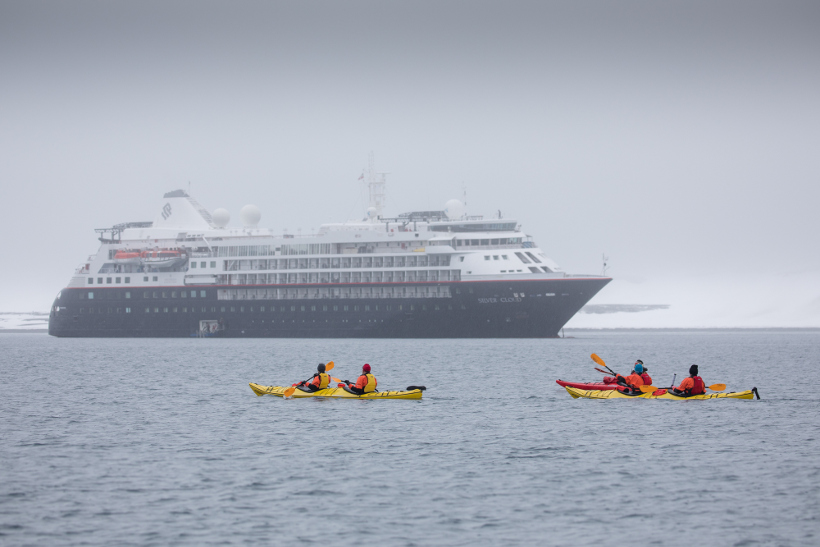 kayaking infront of silver cloud ship antarctica
