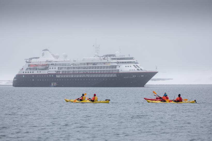 kayaking infront of silver cloud ship antarctica