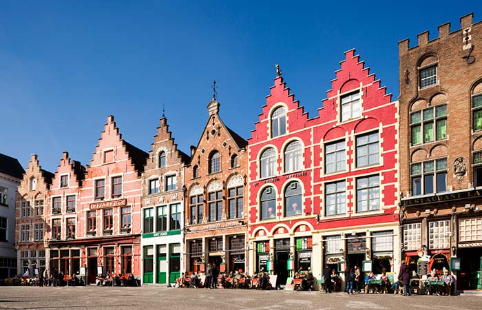 Pretty little houses in Bruges, the setting for the escapades of two hopeless hitmen. Image: Getty.