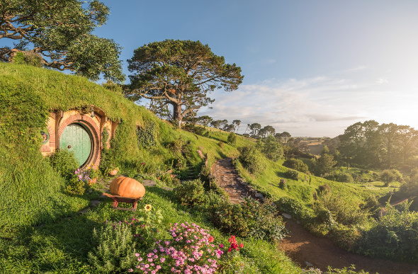 A hobbit hole on the side of a hill