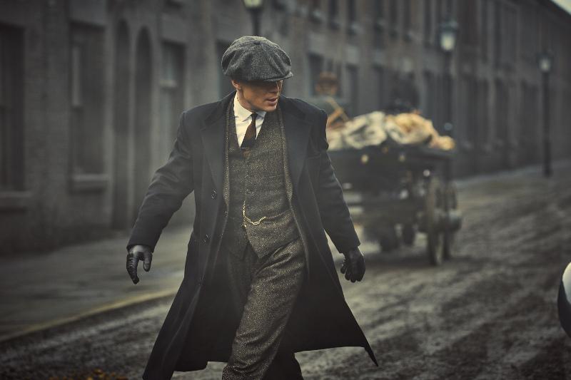 Cillian Murphy as Tommy Shelby on street