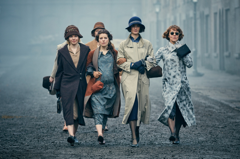 Women in character on 1920s street of Birmingham