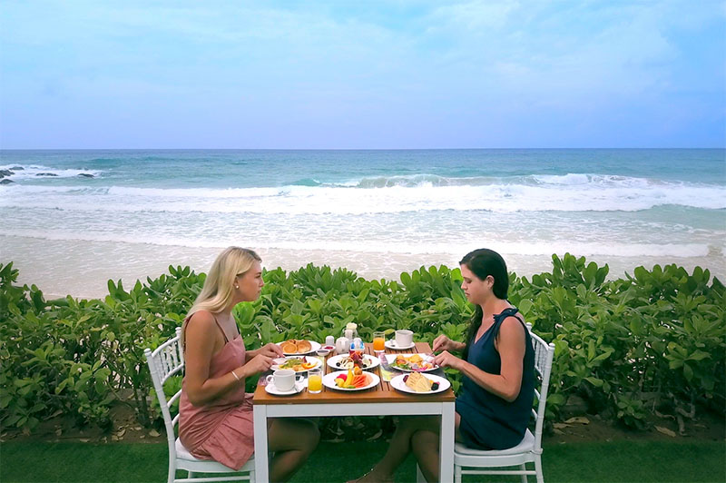 greer and rhi at a private beachfront breakfast