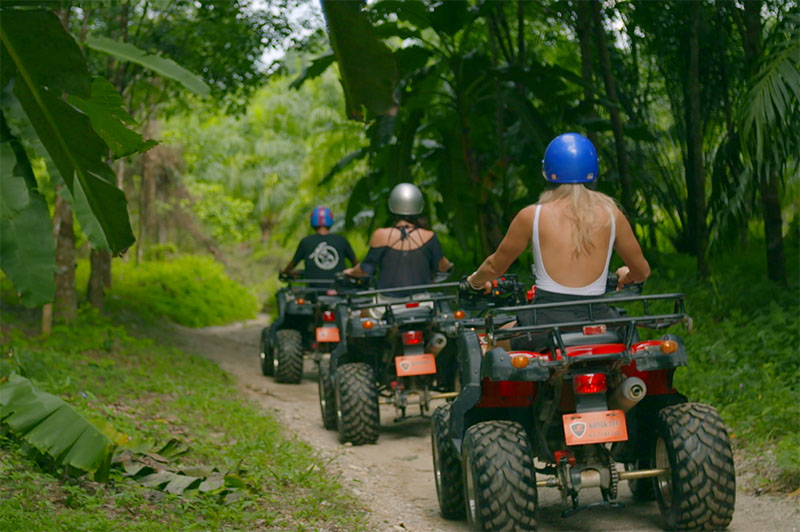 greer and rhiannon on quad bikes in the jungle