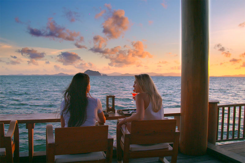 Greer and Rhinannon enjoy sunset drinks