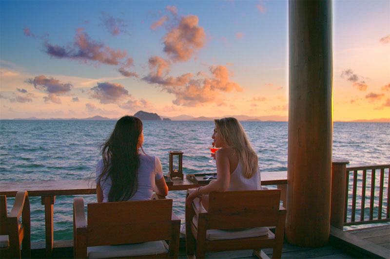 Greer and Rhinannon enjoy sunset drinks