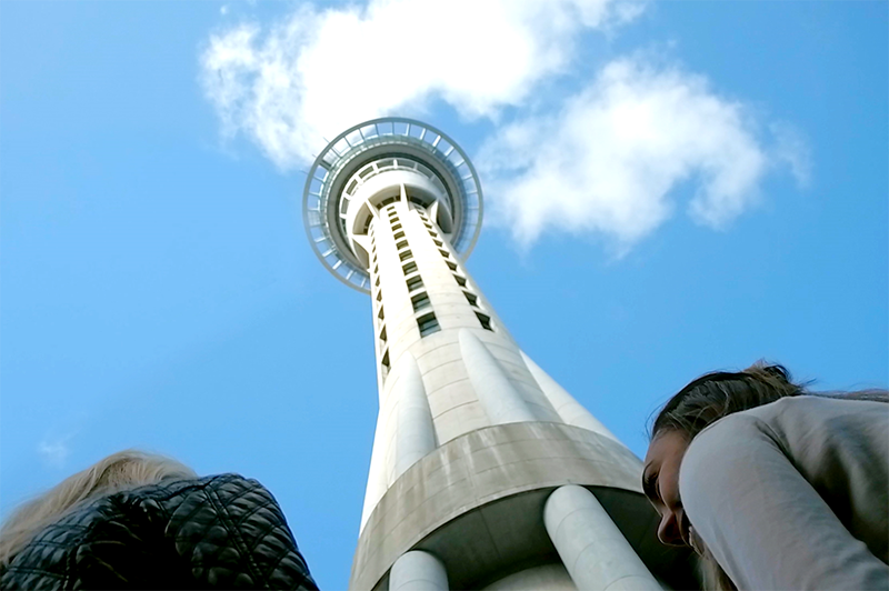 greer looks up at auckland sky tower