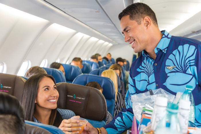 hawaiian airlines extra comfort premium seating serving drinks