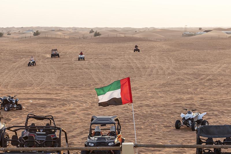 dune buggy in sand dunes near abu dhabi