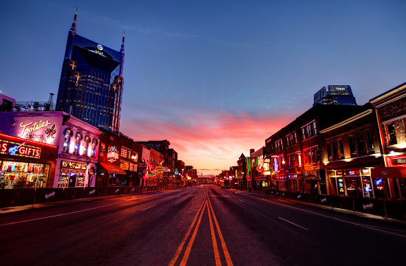 A neon-lit street in downtown Nashville, USA.