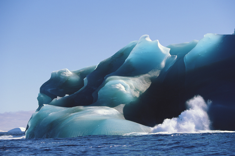 Waves crash against an iceberg in the Drake Passage. Image: Getty