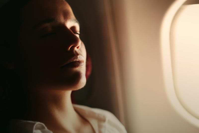 A woman sleeping on the plane