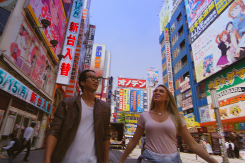 Greer and Keiichi walking down Japanese street