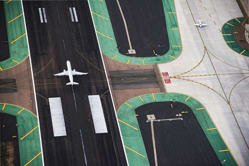 Planes on the tarmac, viewed from above.