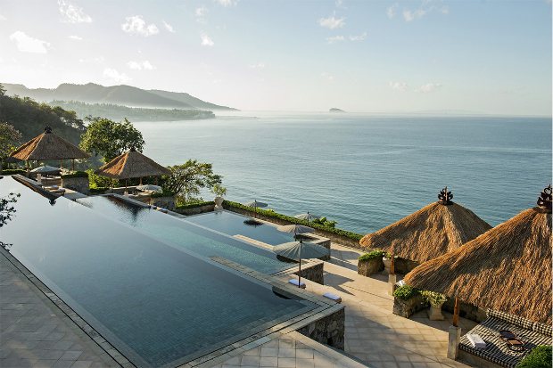 Three tier swimming pool looking over the ocean