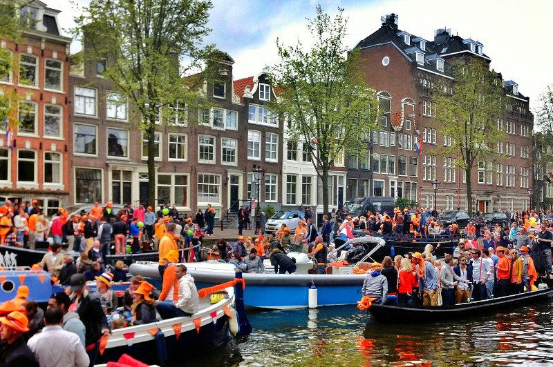 Revellers wear orange to celebrate Koningsdag in the Netherlands.