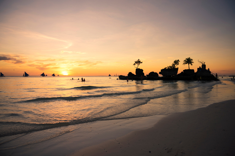 A golden sunset on the island of Boracay in the Philippines.