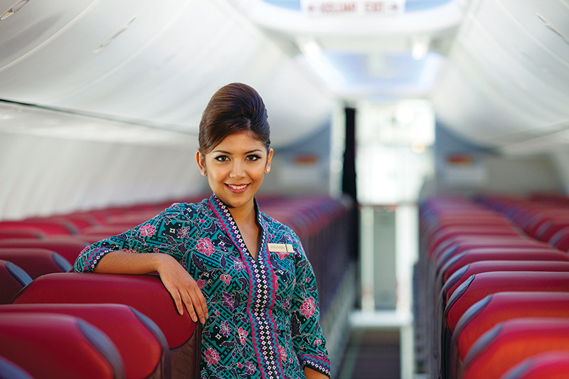 A Malaysia Airlines crew member inside the cabin.
